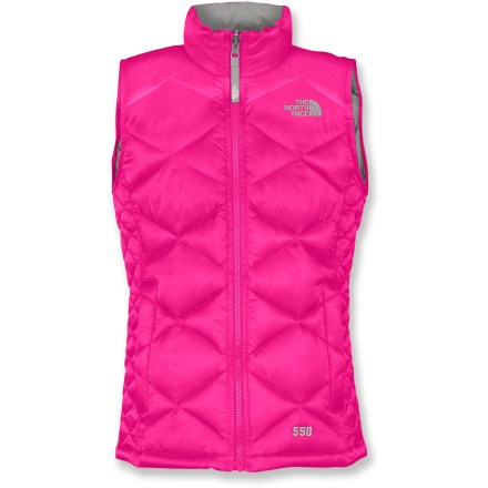 The North Face Aconcagua down vest keeps her warm, comfortable and having fun in chilly weather. 550-fill goose down insulation delivers warmth without weighing you down. Downproof, quick-drying, wind-resistant nylon shell is breathable and treated for water resistance. Stand-up collar has velvety soft lining for added warmth; reinforced windflap behind zipper protects against cold air penetration and zipper snags. Drawcord hem helps seal out cold drafts and retains valuable warmth. Zippered handwarmer pockets quickly warm up chilly fingers. Closeout. - $53.93
