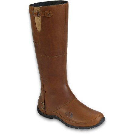 The chic Camryn boots from The North Face offer svelte, equestrian-inspired style you can wear downtown. Waterproof full-grain leather uppers fend off light rain for comfort through the wet seasons. Elastic gore panels and adjustable buckles at shafts accommodate a variety of calf sizes. Compression-molded EVA midsoles cushion feet for traipsing around town. Hardened EVA shanks provide torsional stability and arch support to reduce foot fatigue. Medial zippers allow easy on/off. Durable rubber outsoles on The North Face Camryn boots offer traction for around town. Closeout. - $119.73