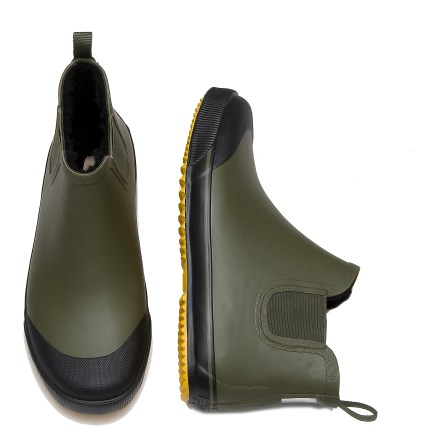The Tretorn Strala Vinter Klar rain boots are a classic option for practical wear in cold, wet temperatures. Over-the-ankle, natural rubber uppers form tough waterproof barriers to keep slush and puddles at bay; elastic side panels ease entry. Nylon pull tab at top of boots gives you leverage to slip feet comfortably inside; tuck your pants into the rubber uppers to keep yourself splash-free. Polyester berber shearling linings are soft to the touch, wick moisture away and boost warmth in cold weather. Rubber midsoles cushion feet and provide gentle support; removable EcoOrthoLite(R) foam insoles enhance comfort. Rubber outsoles on the Tretorn Strala Vinter Klar rain boots use a versatile tread pattern for sure footing on a variety of surfaces. - $34.83