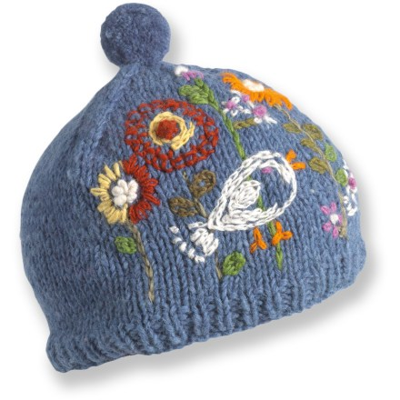 Entertainment The colorful Turtle Fur Shama hat adds fun style to winter wardrobe. Hand-knit wool exterior is lined with soft polyester fleece for excellent comfort and warmth. - $18.93