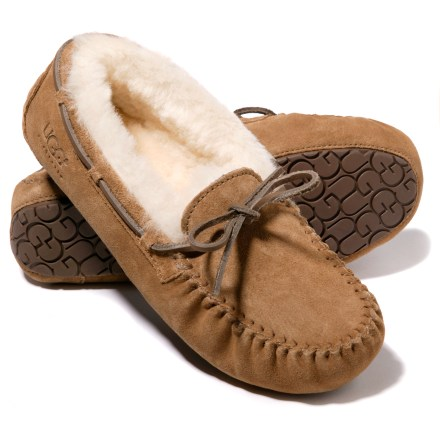 Entertainment UGG Dakota slippers offer the ultimate in cozy comfort for your kids. Moccasin-style, pliable suede leather uppers offer flexibility and durability. Seams are sewn out, away from feet, to eliminate friction and potential sore spots. Lined with plush sheepskin for soft, thermal-regulating warmth and cushioning. Shearling fleece naturally wicks moisture away while allowing air to circulate around feet for breathability and comfort. Designed to be worn without socks; fit should be snug, as sheepskin will stretch and conform to the shape of feet. Wicking sheepskin insoles add cushioning underfoot and help manage moisture. Molded rubber outsoles with UGG logo design offer nonslip traction and water-resistant protection for quick trips outside. - $79.95