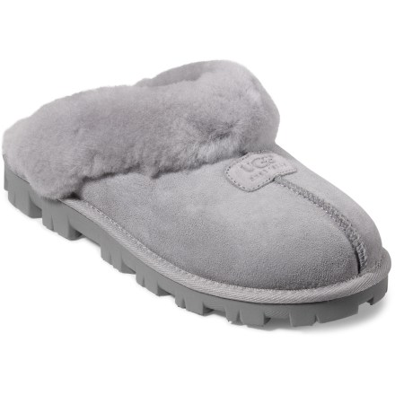 Entertainment With plush comfort and style, the UGG Coquette Shearling Slippers stave off winter chills thanks to soft, cozy shearling linings. Pliable sheepskin uppers are lightweight and breathable. Shearling fleece wool linings naturally wick moisture away while allowing air to circulate around feet for breathability and comfort. All seams are sewn out, away from feet, to eliminate friction and potential sore spots. Reliable traction provided by lugged, compression-molded EVA outsoles. Fit should be snug, as sheepskin will stretch and conform to the shape of your feet; designed to be worn without socks. - $83.93
