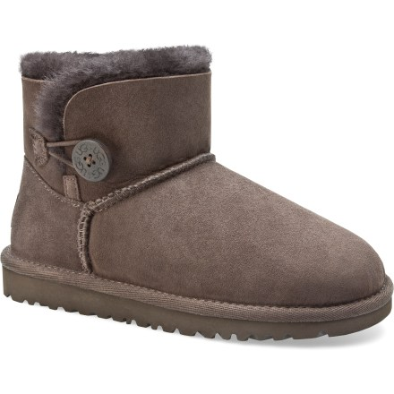 The short and cute UGG Mini Bailey Button boots offer the style and comfort of their taller cousin in a more petite package. High-quality, twin-face sheepskin uppers are soft, warm and breathable; wooden button and elastic band closures add a touch of style and a snug fit. Breathable sheepskin shearling linings let air circulate around feet in both warm and cool temperatures. EVA midsoles and outsoles are lightweight, flexible and durable for support and traction. Designed to be worn without socks; fit should be snug, as sheepskin will stretch and conform to the shape of your feet. UGG Mini Bailey Button boots are available in full sizes only; half sizes should order next smaller size. - $93.93