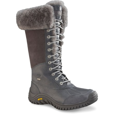 UGG Adirondack Tall women's boots withstand wet winter weather without compromising classic, chic style; they keep your feet dry, warm and comfortable no matter the weather or outfit. Waterproof full-grain leather uppers and suede shafts stand up to winter conditions; twin-face sheepskin collars can be worn up or cuffed down. Tall lacing ensures a personalized fit; shafts are 12 in. tall. eVent(R) waterproof, breathable membranes protect feet from the elements while retaining excellent breathability. Linings and removable, replaceable footbeds feature sheepskin to naturally wick moisture away from feet and offer great, natural insulation. EVA midsoles absorb shock, cushion feet and provide gentle support. Vibram(R) rubber outsoles on the UGG Adirondack Tall women's winter boots ensure confident traction in winter conditions. - $161.83