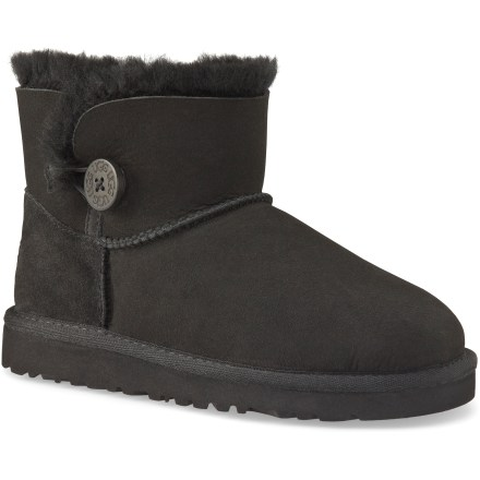These kids' UGG Mini Bailey Button boots offer short and cute style for daily wear. Twin-faced sheepskin uppers are soft, warm and breathable; wooden button and elastic band closures add a touch of style and a snug fit. Breathable sheepskin shearling linings let air circulate around feet in both warm and cool temperatures. EVA midsoles and outsoles are lightweight, flexible and durable for support and traction. Designed to be worn without socks; fit should be snug, as sheepskin will stretch and conform to the shape of feet. UGG Mini Bailey Button kids' boots are available in full sizes only; half sizes should order next smaller size. - $69.93