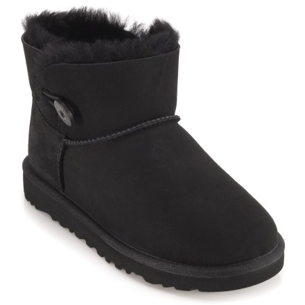 Small in size but big on style, the kids' UGG Mini Bailey Button boots offer plush, cozy sheepskin comfort for casual wear. Twin-faced sheepskin uppers are soft, warm and breathable; wooden button and elastic band closures add a touch of style and a snug fit. Breathable sheepskin shearling linings let air circulate around feet in both warm and cool temperatures. EVA midsoles and outsoles are lightweight, flexible and durable for support and traction. Designed to be worn without socks; fit should be snug, as sheepskin will stretch and conform to feet. UGG Mini Bailey Button kids' boots are available in full sizes only; half sizes should order next smaller size. - $83.93