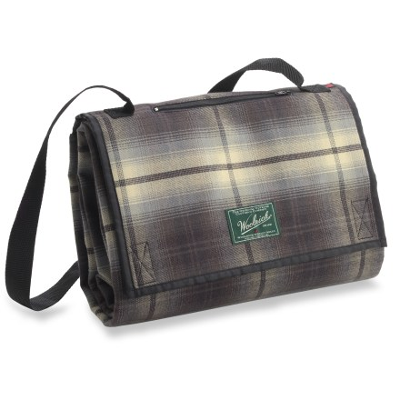 The Woolrich Treeline travel blanket offers rugged style, easy transport and cozy protection from the cold ground-perfect for your next picnic. Wind- and water-resistant blanket features rip-and-stick tabs to keep it folded, a security pocket for small valuables and a convenient webbing shoulder strap. - $59.83