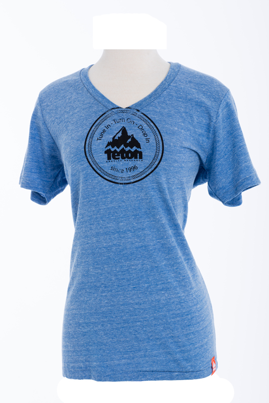Ski Tune In, Turn On, Drop In with Teton Gravity Research's Women's V-Neck Circle Logo T-Shirt. This Eco-Friendly T-Shirt is made with a distressed logo and will help to remind you why you live the way you do....or should.   38% organic cotton, 50% recycled polyester, 12% rayon - $11.95