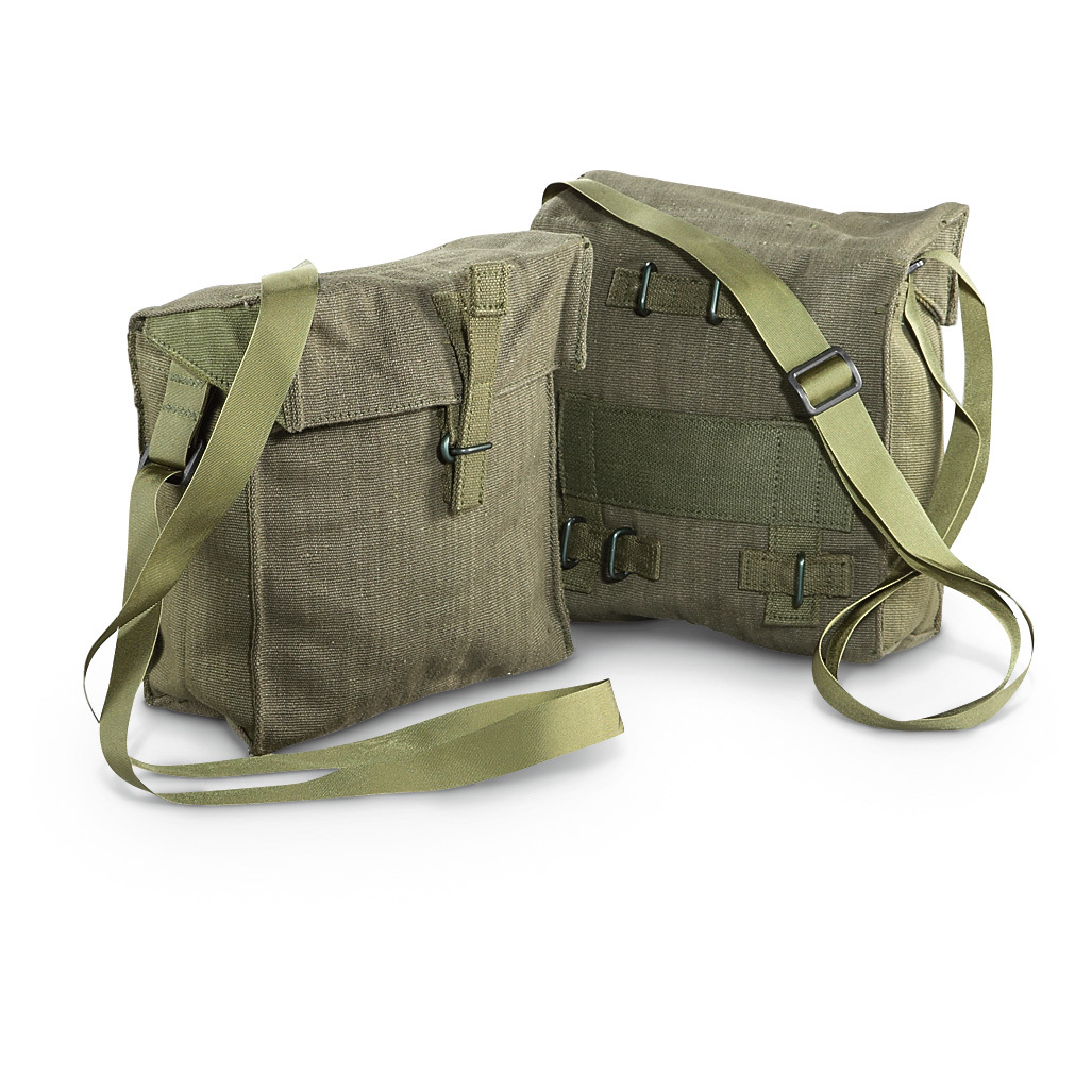 "2-Pk. new British Military Surplus Shoulder Bags. Keep calm and carry on... your Shoulder! You get not 1, but 2 durable canvas Bags. Great for toting smaller items around, just like British troops do. And with 2, you can keep them both, sell 1 as a collector item or give it as a gift! Carry on: British Military issue Olive Drab canvas Top flap has strap closure with black metal hardware Adjustable nylon web shoulder strap 7 x 8 x 3""h., 2.7-liter (168-cu. in.) capacity. Condition: brand new, never issued. Order this handy, practical Military Surplus item today! - $17.99"
