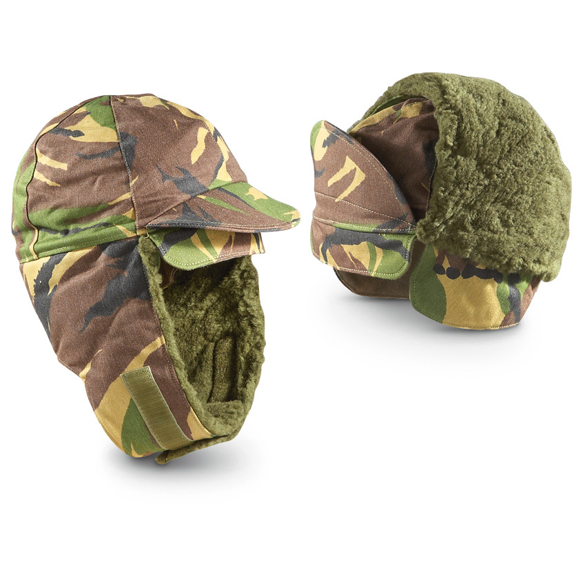 2 Used Dutch Military Surplus Winter Hats. A warm duo, to serve and to protect. Cold front? Reach for these tactical Euro style Hats designed to keep lids toasty warm in icy arctic weather. Polyester / cotton twill Woodland camo shell Simulated-fur cloth earflaps can be worn down or up in warmer weather Short bill offers sun, weather protection Imported Condition: used, in like-new shape. State Size, as available in the Shopping Cart. Nab yours today! !!! Limited Quantities !!! - $16.99