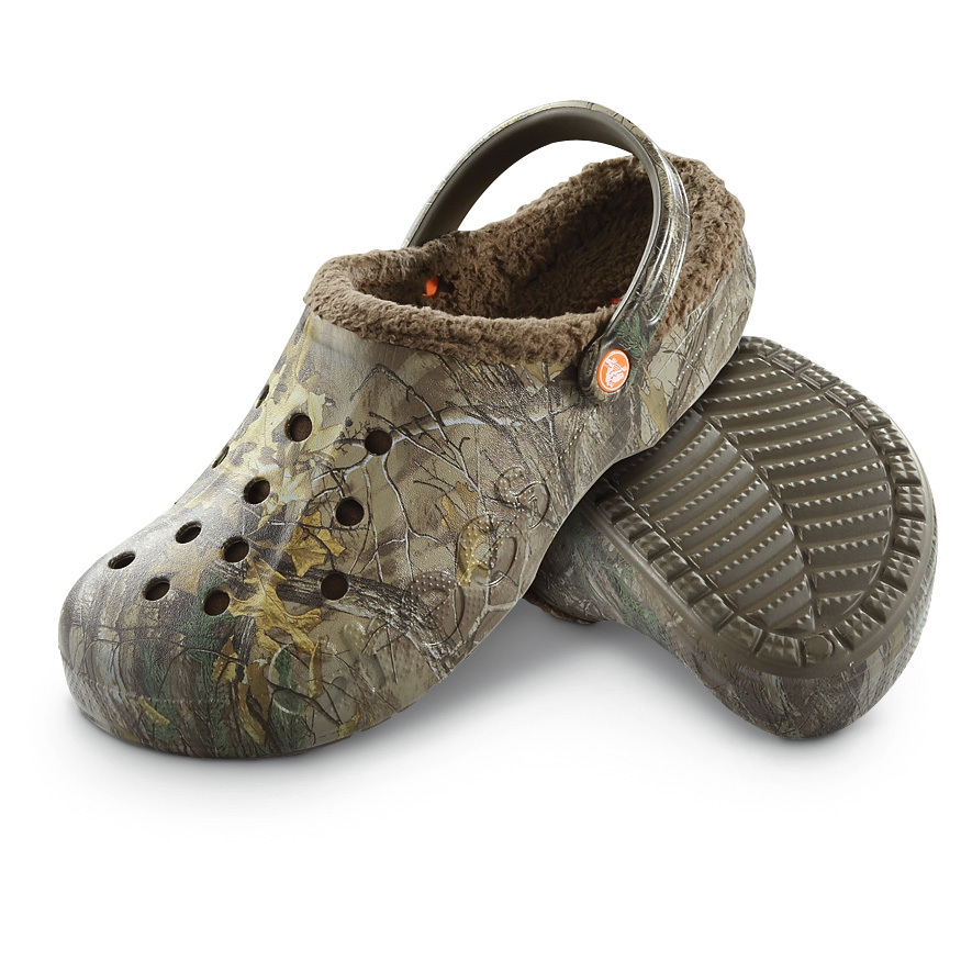 "Crocs Baya Realtree Xtra Lined Clogs are lined with soft, warm fleece for the ultimate in comfort. Just because it gets cold doesn't mean you have to give up the comfort of Crocs! Now you can wear Crocs year round! These Baya Lined Clogs deliver all the lightweight, spring-in-your-step cushioning of the Crocs you know and love, but have soft, warm lining to keep your feet toasty, whether you're indoors or out. Once you slide your feet in, you'll know what incredibly comfortable footwear really is. And this pair is decked out in your favorite pattern... Realtree Xtra Camo, so you can show you passion for the outdoors everywhere you go. Lightweight, cushioning Croslite midsole Realtree Xtra Camo outer Soft, warm fleece lining Heel strap for secure fit Non-marking Croslite outsole Each approx. 4""h., 9 ozs. State Size, as available in the Shopping Cart. - $49.99"