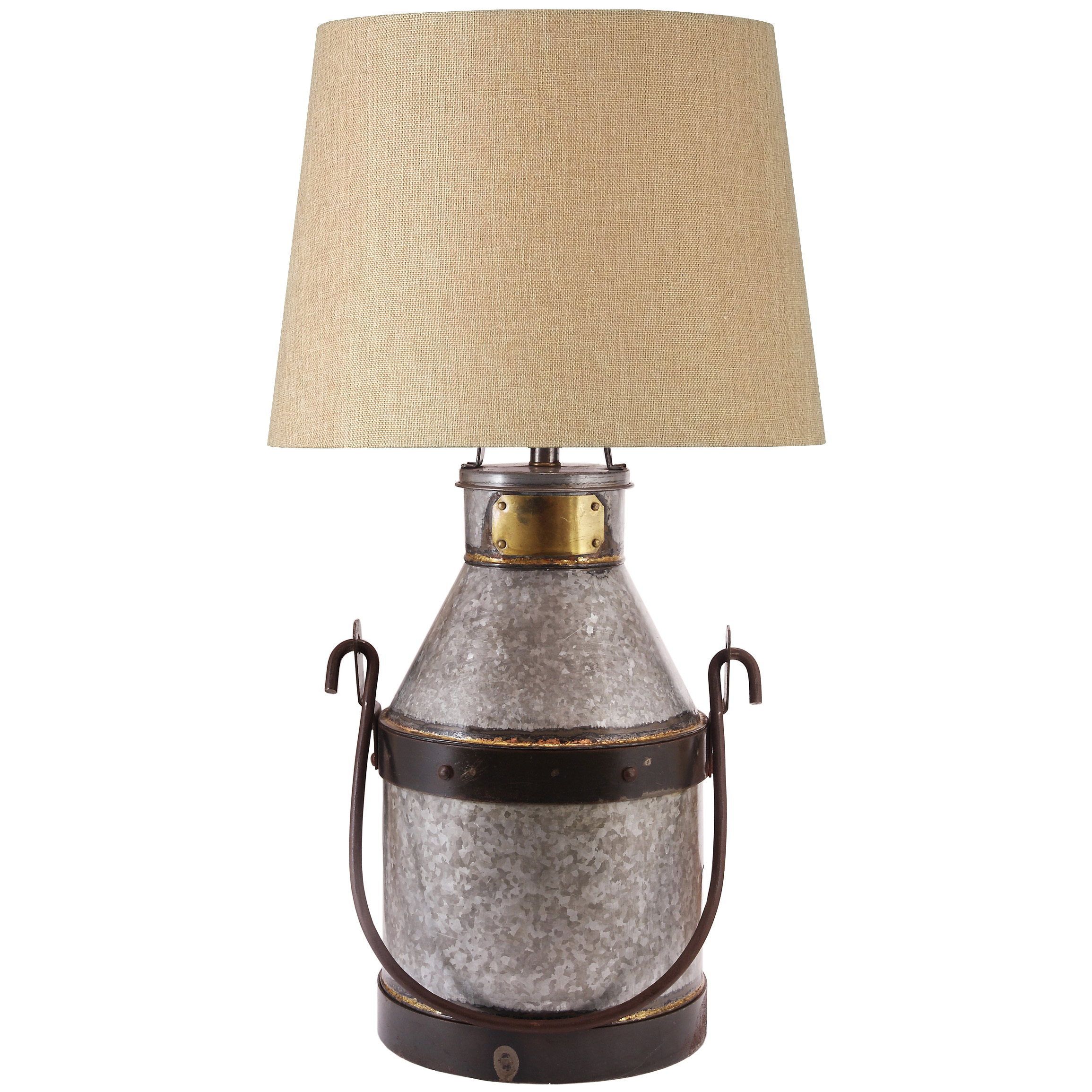 "Kenroy Home Cudahy Table Lamp puts found-object style in a whole new light! Mimicking the classic milk jar of days gone by, the Cudahy Table Lamp brings Old World sophistication to the modern decor. Solidly built from galvanized iron, with bronze finish and felt bottom to protect surfaces. Lamp stands 29""h. Tan fabric shade measures 16"" diam. Uses one 150W bulb (not included). UL Listed. Some light assembly required. - $195.99"