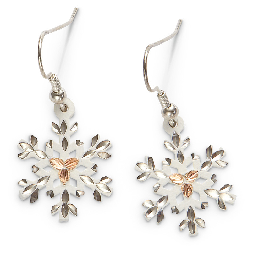 "Landstrom's Black Hills Gold White Snowflake Earrings. Gorgeous jewelry with those unmistakable Black Hills Gold rose gold leaves. This pair of Earrings is the perfect complement to your winter wardrobe! The crisp white sterling silver will look great with any outfit. Each Earring is intricately detailed for a nod to winter's beauty. Beautifully detailed Diamond-cut design White sterling silver with 12k Black Hills Gold rose gold leaves Snowflake measures 5/8 x 7/8""h. Suspends from French wire For pierced ears only. - $59.99"