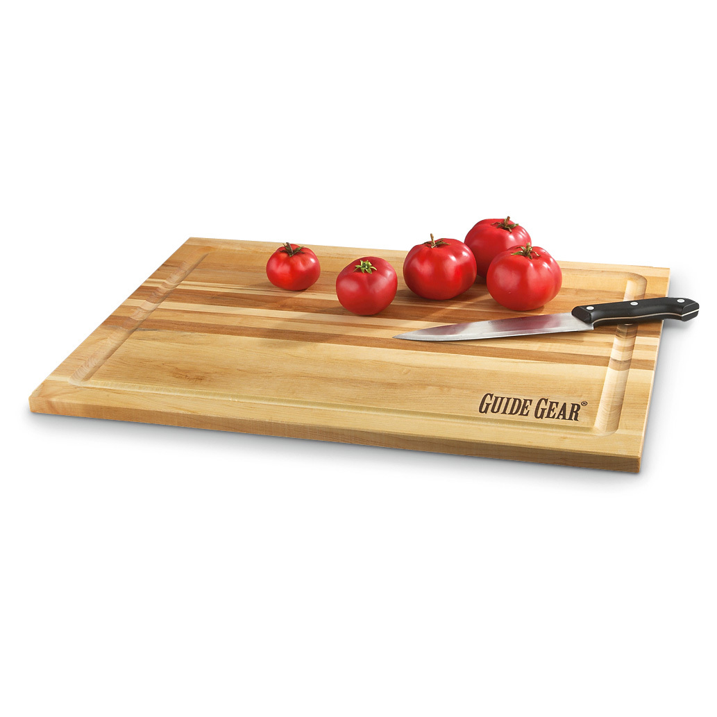 "Guide Gear Maple Carving Board. Carve up a storm! The price is sliced on convenient chopping and cutting. Slice and dice as much as you please atop this genuine maple Cutting Board. Go ahead and get a handle on chopping... veggies, cheeses, nuts, meats and more. Creamy white, close-grain genuine maple wood is soft enough to guide your knife while hard enough to prevent dents. Made directly for Guide Gear, you get top-quality carving for a seriously chopped-down price! Made with pride right here in the USA Self-healing surface for long-lasting use Naturally antimicrobial Juice well for easy cutting with less mess 18"" x 24""l., 3/4"" thick. 8 1/2 lbs. !!! Limited Quantities !!!Built to Sportsman's Guide's exact specifications, Guide Gear stands for dependability, long-lasting quality and unmatched value! Guaranteed! - $29.99"