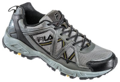 When you're trail running, Fila Ascente 14 Men's Running Shoes are ready for any challenge. These performance athletic shoes are made with a combination of leather, mesh, and canvas for a running shoe that's durable, yet flexible enough to respond to changing terrain. A soft lining and insole keep feet comfortably cushioned, and trail-ready rubber lugs deliver traction wherever you go. Fila Ascente 14 Running Shoes for Men offer outstanding support and shock absorption for walking or running on uneven surfaces. Imported. Manufacturer style #: 331321.Designed for speed and precision off the pavement. Leather, canvas, and mesh provide durability and flexibility. Soft textile lining and insole. Lace-up closure. Pull tab at heel for easy off. Rough rubber lugs grip the ground - $49.99
