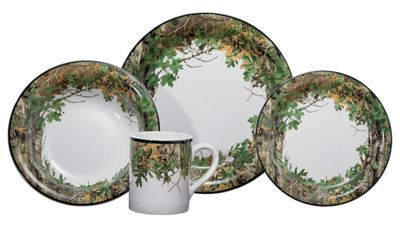 Vivid camo accents this Realtree Xtra Green 16-Piece Dinnerware Set from Bass Pro Shops, making it a great addition to your cabin kitchen. Made of durable 100% stoneware, this outdoor-inspired dish set adds warmth and beauty to your cabin table. This Bass Pro Shops Dinnerware Set includes four 10.23'' x 1.38'' dinner plates, four 7.5'' x 1'' salad plates, four 8.4'' x 2'' bowls, and four 3.3'' x 4'' mugs. All pieces are dishwasher- and microwave-safe.Made of 100% stoneware16-piece set. Includes 4 dinner plates, 4 salad plates, 4 bowls, and 4 mugs. Microwave- and dishwasher-safe - $59.99