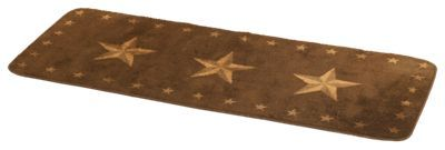 Spruce up your home or cabin with the Star Print Runner Rug. Showcasing 3 large stars, this handsome throw rug features a smaller stars border and a rubber backing for traction. Great for the bathroom or kitchen, this 100% polyester rug makes a great housewarming gift! Measures 24inch x 60inch. Wash delicate, hang dry. Imported.Rug showcases 3 large stars bordered by smaller stars. Rubber backing for stability100% polyester. Measures 24inch x 60inch - $59.99