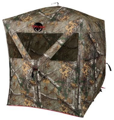 Ideal for both gun and bow hunting, The Crush Enforcer Ground Blind from Ameristep conceals up to 2 hunters with plenty of room. Made of a tough and durable 600D fabric, this hub-style blind features Ameristep's Rugged Shield weather resistant technology outside. Inside, Carbon Enhanced Shadow Guard technology helps conceal movement and shadows from wary eyes outside the blind. Spider Hub frame offers quick and easy set. Shoot-through mesh windows allow you to remain totally concealed as you draw your bow or raise your gun to fire through the blind's 69inch of shooting width. Ceiling Height: 66inch. Hub-to-Hub: 69inch. Weight: 15 lbs.Manufacturer model #: 1RX2H016LFR.Easy-to-use ground blind that's great for gun or bow season. Plenty of room for 2 hunters. Fast-and-easy Spider Hub frame - easy setup/take down. Carbon enhanced Shadow Guard interior - conceals movement and shadows. Insect- and weather resistant. Durable 600D fabric shell. Shoot-through mesh windows - $159.99