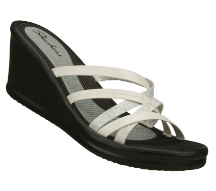 Surf Get deeply involved in warm weather style with the SKECHERS Cali Rumblers - Tangled sandal.  Smooth faux leather upper in a wedge heeled strappy slide sandal with print detailing. - $34.50