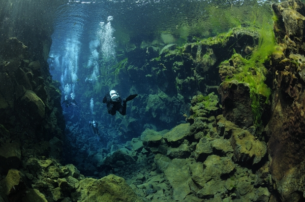 Scuba SILFRA CLEFT, ICELAND - With visibility exceeding 325 feet, Silfra's depth and colors mesmerize