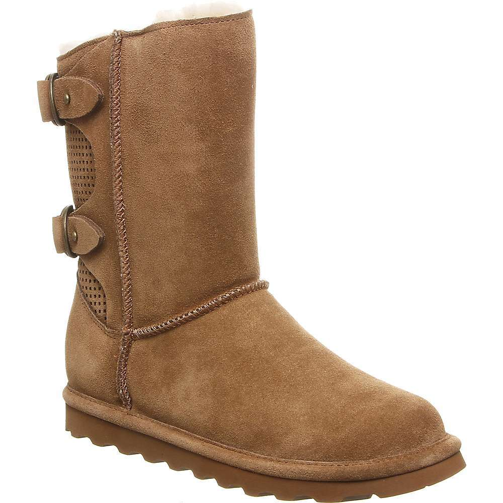 Features of the Bearpaw Women's Clara Boot 8 inches tall Cow suede (Black, Hickory, Navy, Wine) or distressed textured (Chestnut) Upper Geometric perforations accent back panel Double D-ring straps cinch the back Wool blend lining Sheepskin comfort Footbed Lightweight blown rubber Outsole Treated with NeverWet Technology - $109.95