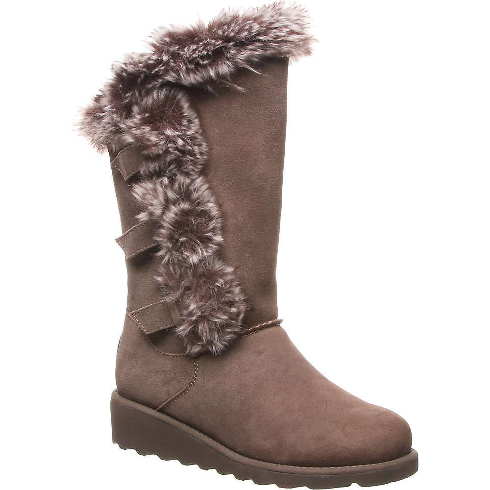 Features of the Bearpaw Women's Genevieve Boot 12in. Tall cow suede boot, Features a triple buckle wrapped in fur design with an angled top collar line NeverWet Technology for protection from the elements Wool blend lining with a removable sheepskin comfort Footbed on our lightweight blown rubber wedge Outsole Superhydropht Technology that repels stains from liquids and cleans dirt/debris easily with water - $119.95