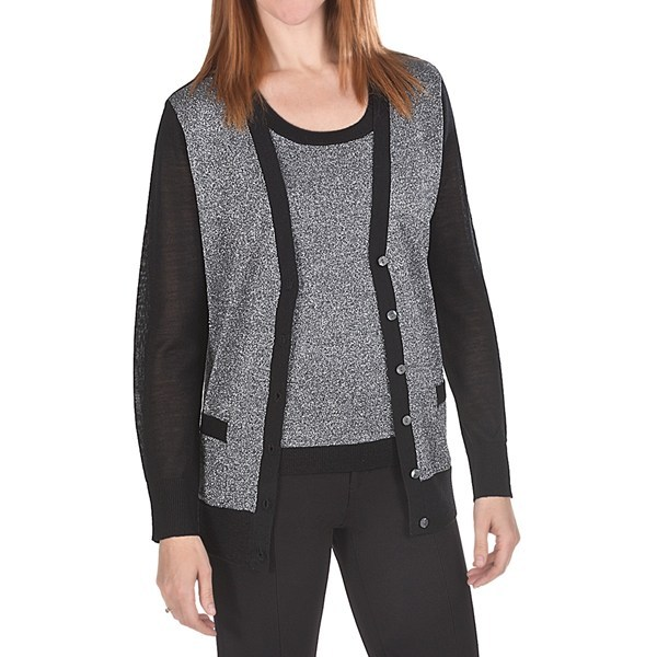 CLOSEOUTS . Traditional twinset styling radiates special-occasion sparkle in this Joan Vass cardigan sweater -- knit from wool, acrylic and silvery metallic yarns that spread glitter and cheer across the front. Available Colors: BLACK. Sizes: 0, 1, 2, 3. - $9.79