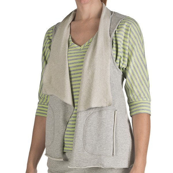 CLOSEOUTS . An exuberant collar frames the open front of Nomadic Traders' flutter collar vest, crafted of a heathered French terry with rolled edges and a unique crossover back. Available Colors: HEATHER GREY. Sizes: S, M, L, XL. - $7.80