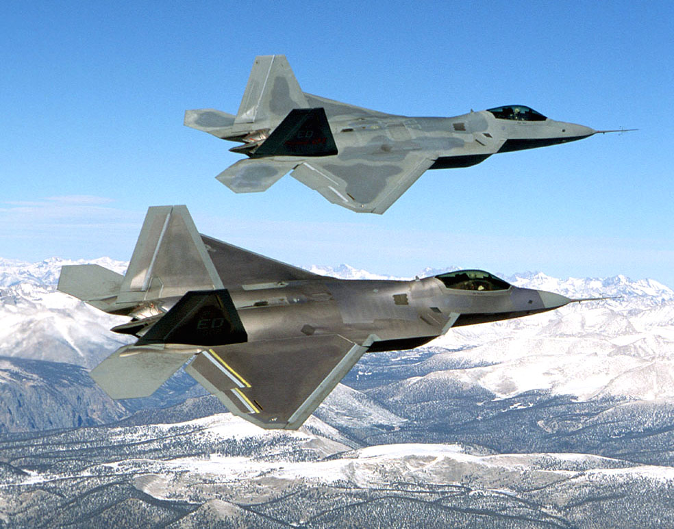 Guns and Military Two F-22 Raptor