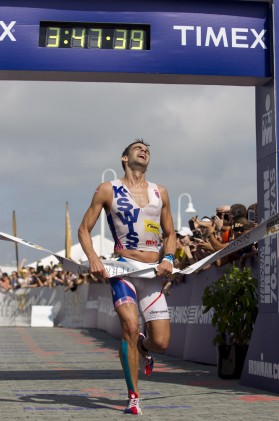 Fitness Timothy O'Donnell hoists the ribbon after winning the Hermann Memorial Ironman 70.3 Texas.