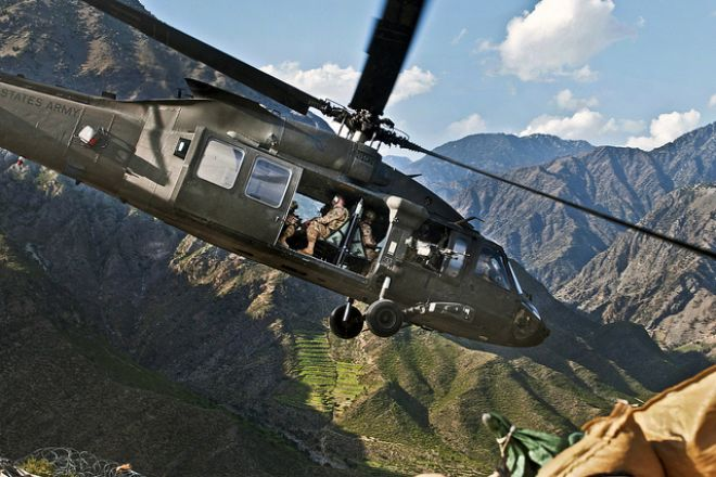 Guns and Military April 3, 2012: Army officers depart a combat outpost on a UH-60 Black Hawk helicopter near Jalalabad, Afghanistan.