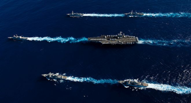 Guns and Military Feb. 15, 2012: U.S. Navy ships transit the Pacific Ocean.