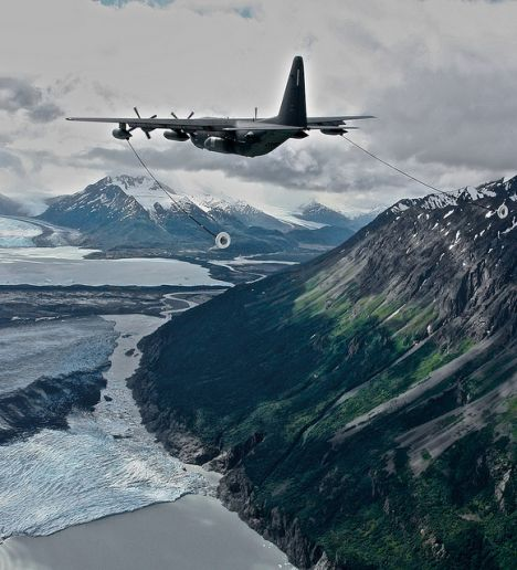 Guns and Military Mar. 16, 2012: A King cargo aircraft flies over Alaska ready for aerial refueling.