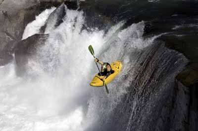 Kayak and Canoe A kayaker plunges over a waterfall on the Cheakamus River near Vancouver, Canada.