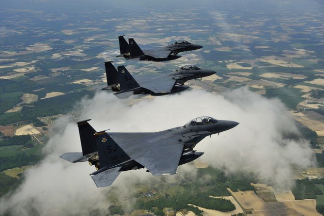 Guns and Military April 16, 2012: U.S. Air Force F-15E Strike Eagle fighter aircraft fly in formation.