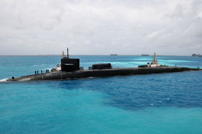 Guns and Military Sept. 5, 2011: The Ohio-class guided-missile submarine USS Georgia (SSGN 729) prepares to moor outboard of the submarine tender USS Emory S. Land (AS 39) in Diego Garcia.