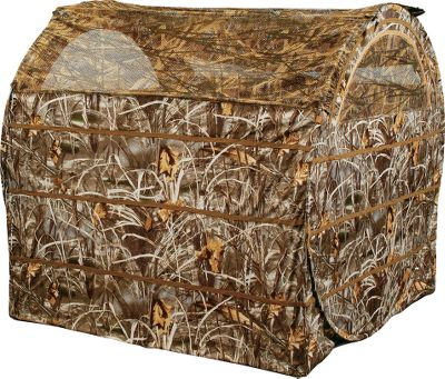 Hunting With its effortless transport, ultra-fast setup and full, incredibly realistic concealment, the Hayhouse is ideally suited for waterfowlers who spend the majority of their hunting season moving from field to field. At a full 5-feet long x 5- feet high, it easily accommodates two sitting hunters and all of their gear. And with just a pull of a single rip cord, the top third of the blind pops open for immediate shooting action. Adjustable camo mesh side windows offer a completely unobstructed view of incoming birds. Tough weatherproof nylon shell material guarantees season after season of lasting performance and integral brush pockets let you quickly customize the blind with natural foliage and vegetation so it effectively blends with the surrounding terrain. It packs into the included 6 x 28 matching camo backpack for easy carrying. Plus the pack has a roomy compartment for stowing silhouette decoys and straps and buckles for securely attaching chairs. Blind also includes stakes and high-wind tie-downs. Imported. Weight: 14 pounds. Camo pattern: Realtree MAX-4. Color: Max 4. Type: Hay Bale Blinds. - $149.99