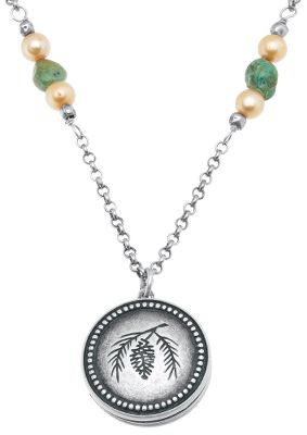 Entertainment Perfect jewelry addition for holding a photo of that special someone close to your heart. Traditional antiqued silver pine cone locket features turquoise and gold pearl. Each locket is crafted using only lead-free alloys and silver plating with a tarnish-resistant finish. Pendant dimensions: 1 dia. Chain length: 22L; adjusts to 17L. Color: Silver. Gender: Female. Age Group: Adult. Type: Necklaces. - $39.99