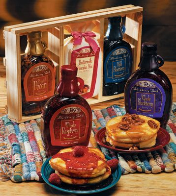 Transform your breakfast time from a usual routine to a culinary event with delicious pancakes and syrup in these Blackberry Patch Gift Crates. Each comes with two 12-oz. fruit syrups, including one with raspberry and blackberry syrups and the other with sumptuously unique roasted pecan and blueberry flavors. The syrups are made from whole, ripe berries and nuts, and also make great toppings for ice cream and other desserts. You also receive a 12-oz. package of pancake mix that's easy to use because all you do is add water. The syrups and mix come in a special hand-crafted wooden gift box set that's a great gift idea for the holidays. Available: Raspberry/Blackberry, Roasted Pecan/Blueberry. Type: Food Kits. - $24.99