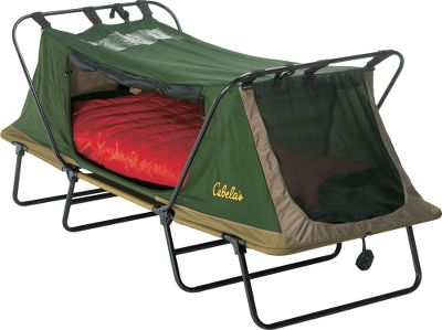 Camp and Hike The convenience of a cot and tent in one easy-to-set-up package. The tent body is 70-denier, 190T nylon taffeta with a 600-denier polyester floor supported by a heavy-duty, powder-coated steel frame. Includes a full-coverage fly made of 75-denier, 190T polyester taffeta with a 1,500mm waterproof-rated coating, meaning you stay dry regardless of conditions. A patent-pending rain-gutter system on the fly channels water off and away from zippers, and seams are fully taped for maximum protection. Zippered door on the fly converts to an awning using included poles and guy ropes. One end door, one side door and two windows. Windows and dual-track doors have No-See-Um mesh. The heavy-duty zippers have reflective pulls. A crack-resistant roof window lets you fall asleep under the stars. Inside, youll find the convenience of cup holders, and there is an organizer panel to keep essential items close at hand. Both models fold up and include a zippered storage bag. Imported. Size: SINGLE. Color: Green. - $279.99