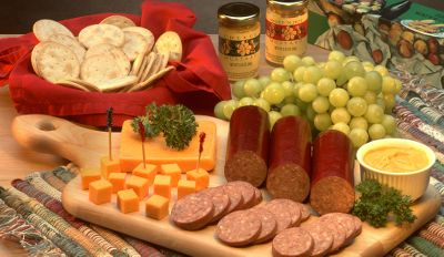 Hunting Gifts of food are always a great way to express thanks to friends, family or co-workers. Our Sausage and Cheese sampler pack tastes so good and is priced so reasonably, youll keep one on hand for parties or special gatherings at your home. Our sampler has delicious sausages, cheese, mustards and crackers. Comes in a handsome gift box. Our food makes a great gift for family, friends or business associates. To place a multi item food order for your business please contact Cabelas Corporate Outfitters at 1-800-243-6626. Sampler includes: 6 oz. Elk Summer Sausage/Pork 6 oz. Venison Sausage/Pork 6 oz. Wild Boar Sausage/Pork 4 oz. Hot Pepper Cheese Bar 4 oz. Cheddar Cheese Bar 1.4 oz. Sweet Hot Mustard 1.4 oz. Stone Ground Mustad 4 oz. crackers Color: Mustard. - $44.99