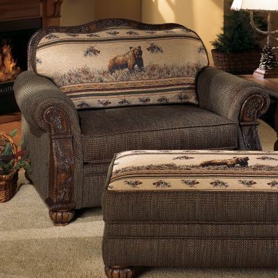 Hunting Peerless craftsmanship and handsome aesthetics make the Pine-Cone Lodge Furniture Collection some of the finest furniture ever offered by Cabelas. The chair is available in your choice of two wonderful nature themes captured on a richly woven tapestry with chenille accents. The marbled body fabric depicts a barklike effect. The blending of the yarns ensures superb durability and wear resistance. Seat cushions are reversible, allowing for subtle mood changes. Rubbed rich Kodiak-brown finish enhances the depth of the hand-carved pine-cone designs and grain of the ash wood, which accent the arm and back collar of the chair. Features kiln-dried, hardwood frame construction; level support coil seating; wrapped, high-resiliency polyurethane seat cushioning; and plush body cushioning. Limited lifetime warranty. Made in USA. 52L x 40D x 40H. Available: Kodiak, Bear. Type: Chairs. - $1,499.99