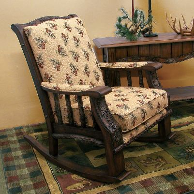 Hunting Add a wood-framed rocker with soft golden chenille upholstery and pine-cone and pine-bough accents to your set. Peerless craftsmanship and handsome aesthetics make the Pine Cone Lodge Rocker one of the finest pieces of furniture ever offered by Cabelas. Made in USA. 31L x 37W x 42H. Available: Kodiak, Pine Cone. Please allow 4-12 weeks for delivery via motor freight. Type: Rocking Chairs. - $1,099.99