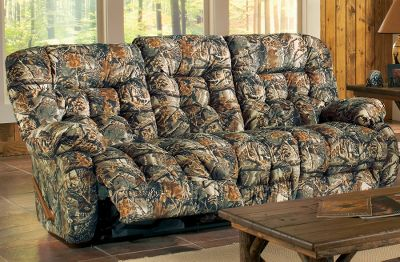 Entertainment After a hard day in the field or at the office, kick up your feet and let yourself melt into this luxurious Kipling Camouflage Motion Sofa. Heavy-duty, all-steel reclining mechanism ensures smooth, responsive reclining on demand. Hardwood frame is meshed with high-strength secure points that are doweled, screwed and glue-reinforced with steel plates. All springs are heat-tempered for strength and long life. Tear- and stain-resistant seats are constructed of premium, high-density polyurethane foam and fiberfill. Made in USA. 42H x 87W x 40-1/2D. Camo patterns: Cabelas Seclusion 3D, Realtree AP, Mossy Oak Break-Up. Color: Seclusion 3D. Type: Sofas. - $1,299.99