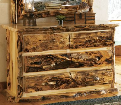 Entertainment If you love the gnarly, knotty character of weathered wood, you will love the look of our unique handcrafted bedroom furniture. The dressers are individually crafted by master furniture makers known for bringing out the best this wood has to offer. The pieces are hand-sanded, then rubbed with beeswax and linseed oil to bring out their natural shine. The mortise and tenon construction in each joining piece ensures strength and product longevity. The Old-World construction and finishing techniques will provide years of enjoyment. Complete your dream bedroom by complementing the dresser with a range of accessories that pull together your rustic dcor. Made in USA. 32H x 54W x 21D. Color: Natural. - $2,299.99
