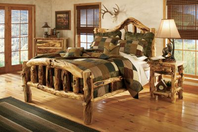 Entertainment If you love the gnarly, knotty character of weathered wood, you will love the look of our unique handcrafted bedroom furniture. The log beds are individually crafted by master furniture makers known for bringing out the best this wood has to offer. The pieces are hand-sanded, then rubbed with beeswax and linseed oil to bring out their natural shine. The mortise and tenon construction in each joining piece ensures strength and product longevity. The Old-World construction and finishing techniques will provide years of enjoyment. Bed features double-side rails for solid support, and self-supporting slats to hold a mattress and box spring. Complete your dream bedroom by complementing the bed with a range of accessories that pull together your rustic dcor. Made in USA. Available: Twin, Full, Queen, King. Color: Natural. Type: Beds. - $1,699.99