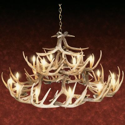 Hunting Our 30-antler whitetail chandelier is professionally handcrafted from reproductions of real antlers. Plus, its a fraction of the cost of a real antler chandelier. Each antler is made of a medium-density polyethylene material that is lighter in weight than conventional antlers and just as durable. Hand-stained and -rubbed to achieve the authentic look of natural antlers. Candelabra-style lights utilize 25-watt candle lights to create a warm, natural look in any room. (Lights sold separately.) Elegant brass hanging chain secures chandelier to the ceiling. Includes mounting hardware and ceiling plate. Shipped via truck. Made in USA. 50W x 27H. Color: Natural. - $1,119.99