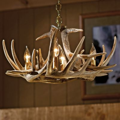 Hunting Our six-antler whitetail chandelier is professionally handcrafted from reproductions of real antlers. Plus, its a fraction of the cost of one composed of real antlers. Each antler is made of a medium-density polyethylene material that is lighter in weight than conventional antlers and just as durable. Hand-stained and -rubbed to achieve the authentic look of natural antlers. Candelabra-style lights utilize 25-watt candle lights to create a warm, natural look in any room. (Lights sold separately.) Elegant brass hanging chain secures chandelier to the ceiling. Includes mounting hardware and ceiling plate. Made in USA. Measures: 24W x 11H. Color: Natural. - $239.99