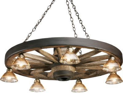 This lodge-style chandelier will brighten any room in your home or cabin and adds a subtle touch of traditional outdoor style. The Wagon Wheel Reproduction Chandelier is made from a medium-density polyethylene that is hand-stained and rubbed to achieve an authentic look. Seven down lights (60-watt max. each) and amber glass globe shades. (Bulbs sold separately.) Includes hanging chain, mounting hardware and ceiling plate. Made in USA. Dimensions: 12 H x 42 W. Color: Amber. - $599.99