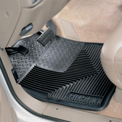 Motorsports Husky Liners Heavy-Duty Floor Mats have an extra-thick heel pad on the drivers side to fight fatigue on long drives and deliver extra durability in this high-wear area. Made with rubberized DuraGrip that takes on abuse with ease. They conform to the contours of your vehicles floor and use StayPut cleats to ensure they dont slide around underfoot. Raised edge keeps messes off your vehicles carpet, while raised ridges provide water channels to keep feet out of the muck. Easy to install, remove and clean. Manufacturers lifetime warranty. Fit most vehicles. Made in USA. Per pair. Colors: Black, Gray, Tan. Color: Black. Type: Cargo & Floor Mats. - $54.99